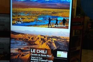 Publicité en partenariat dans les vitrines d'un réseau d'agences de voyages